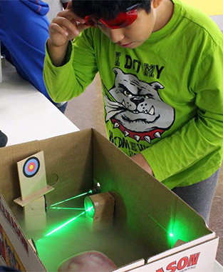 student with laser experiment